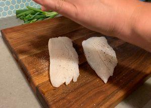 seasoning rockfish fillets with fresh ground black pepper