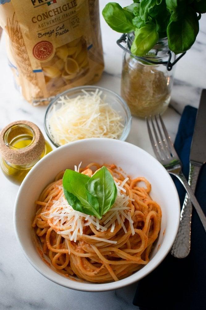pink pasta sauce recipe with fresh basil as a garnish