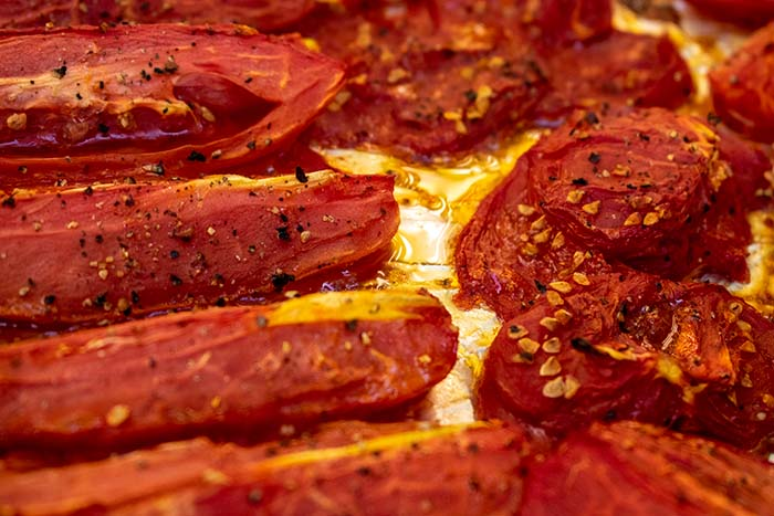 Oven Roasted Tomatoes Recipe with cracked red pepper and olive oil