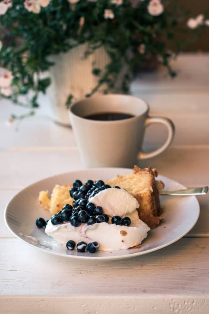 bread pudding recipe without raisins sides showing coffee, ice cream, and fresh fruit